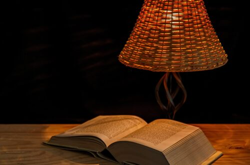Bedside table with a lamp and book for relaxing bedtime