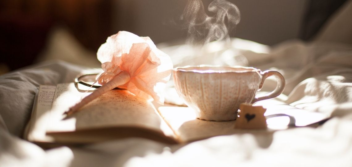 tea with book in bed